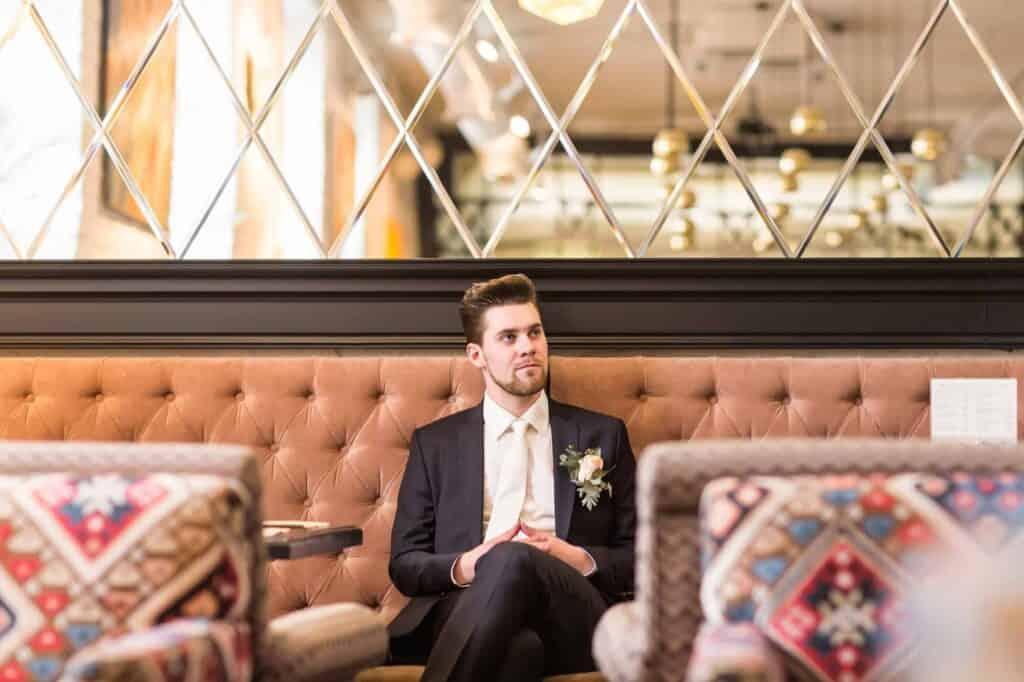 Handsome man sitting in luxury chair
